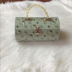 Hello kitty green metal purse